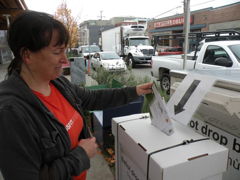 Susan Hood turned in two ballots at the drop box outside Seattle's public library in Ballard. She says she's just used to voting on Election Day, like she did with her parents when she was younger.