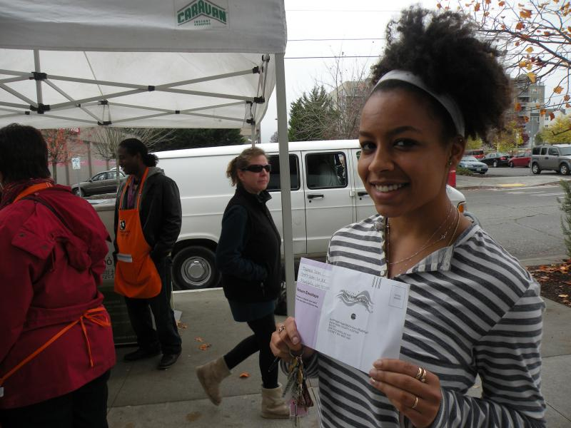 20-year-old Seattle voter Tajanna Stinn says she's excited to be voting for the first time, but needed time to decide how to vote on the initiative that would allow charter schools in Washington. She hand-delivered her ballot to the drop box in Ballard.