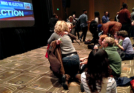 Democratic supporters embrace as news of Obama's re-election is broadcast on the big-screens at the Westin in downtown Seattle.
