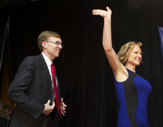 Republican candidate for Washington governor Rob McKenna concedes election. He is shown here Tuesday night with his wife.