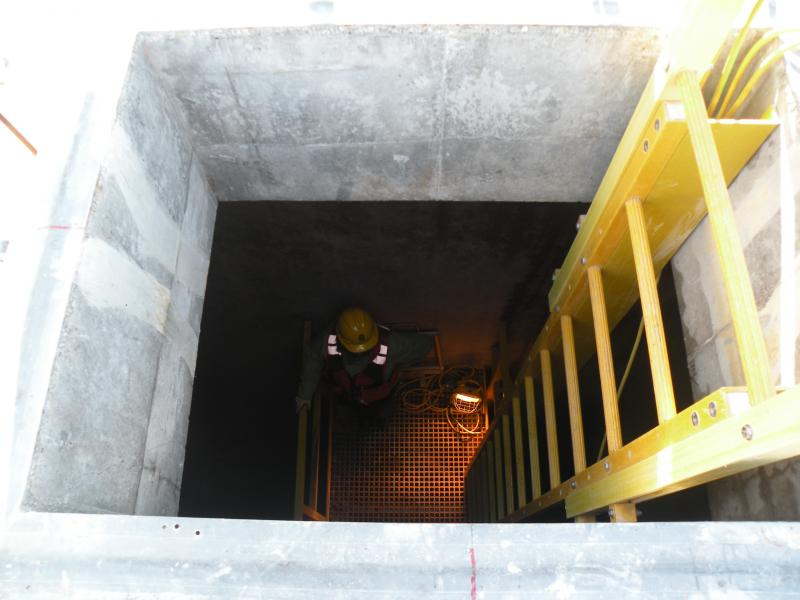 A steep ladder leads down to hollow chambers, where repair work can be seen from the inside