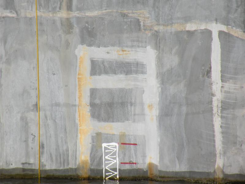 Chalk markings on the outside wall of the pontoons show where they sit in the water and how repair work is progressing.