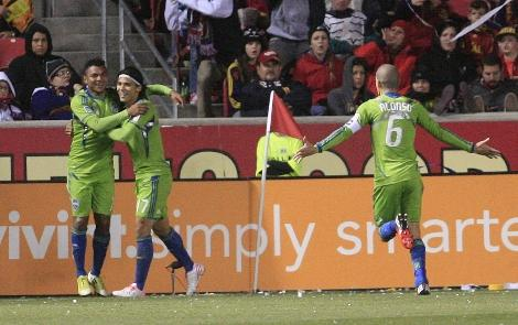 Seattle Sounders Mario Martinez celebrates with teammates Fredy Montero and David Estrada after scoring the only goal in the Western Conference semifinal match with Real Salt Lake Thursday in Utah.