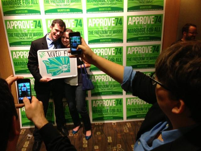 Supporters of same-sex marriage pose at the Democrat's party at the Westin Hotel in Seattle.