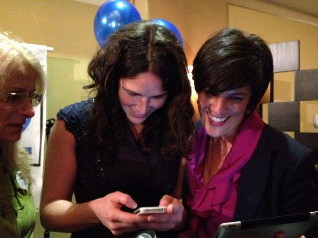 At right, Alison Holcomb, one of the lead organizers for I-502, checks result at the pro-I-502 party in Seattle.