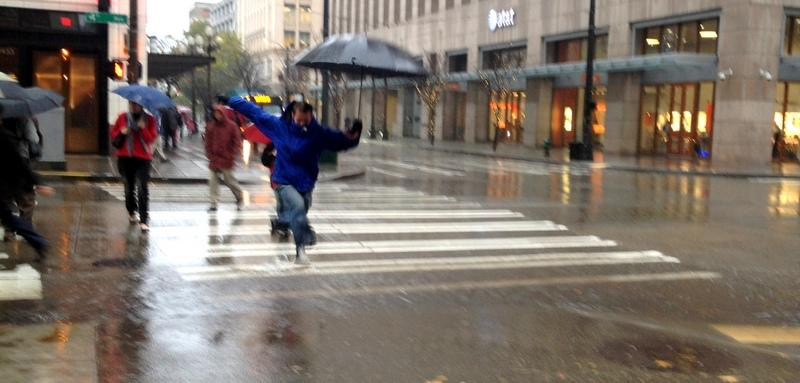 Seattle pedestrians had to jump from here to there at some street corners as the rains fell hard this morning.