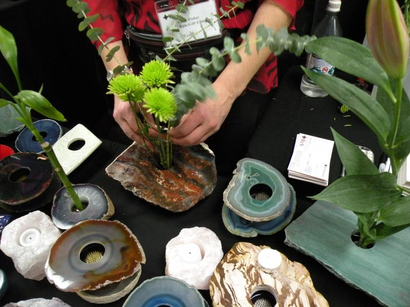 One of the newest members of BizXchange's bartering network is a gift shop owner who has two storefronts near Pike place Market. Clare Fisher of Pacific Rain Gift Company was selling excess inventory including Ikebana supplies at the BizX Holiday expo.