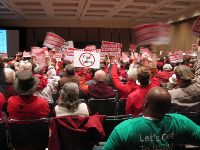 Inside the convention center, red shirts of opposition outnumbered the green Ts worn by backers of the Gateway Pacific coal terminal.