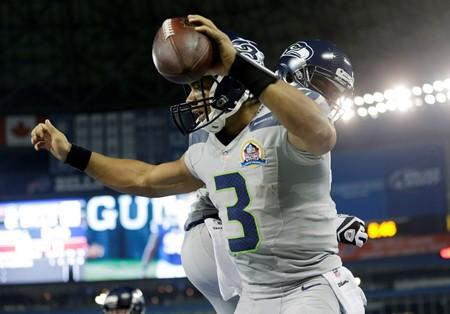 Seahawks quarterback Russell Wilson reacts after scoring a touchdown against the Buffalo Bills Dec. 16 in Toronto.