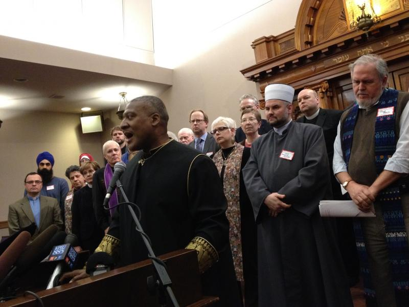 Rev. Leslie Braxton and other clergy call for action to prevent gun violence.