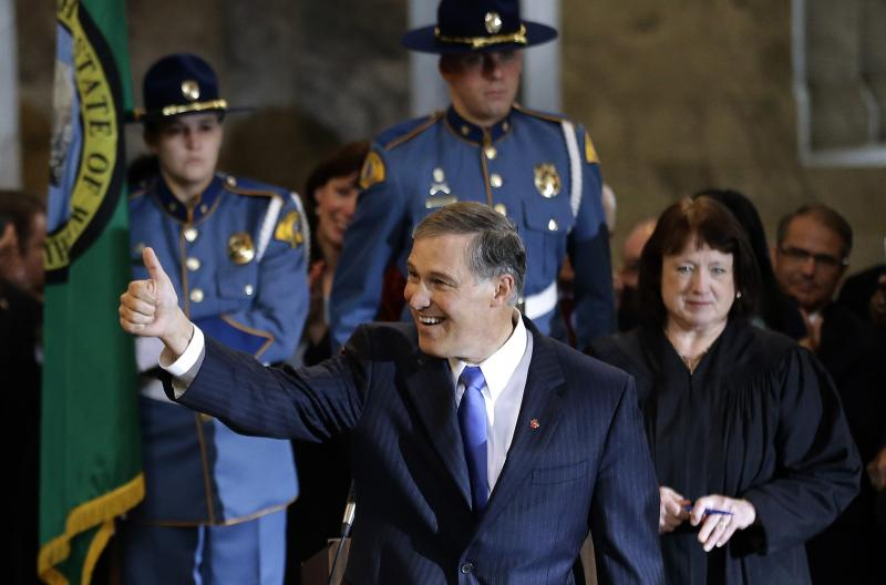 Jay Inslee gives a thumbs-up after being sworn in as Washington state Governor on Wednesday.
