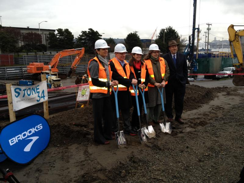 Speakers at the groundbreaking included Skanska USA VP Lisa Picard, Brooks Sports CEO Jim Weber, Seattle Mayor Mike Mcginn and Cathy Tuttle with Seattle Neighborhood Greenways. Brooks is moving its global headquarters to the building from Bothell.