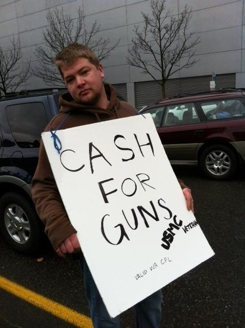 One of the many private gun buyers trying to make deals with people wating in line.