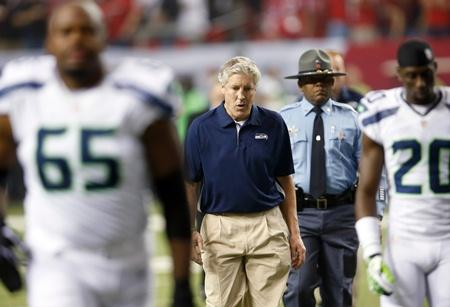Seahawks head coach Pete Carroll walks off the field during the first half of Sunday's playoff game against the Falcons in Atlanta.