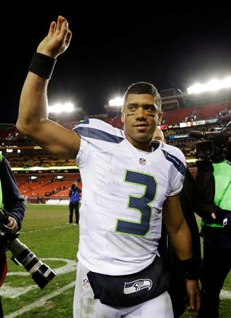 Seahawks quarterback Russell Wilson waves as he leaves the field after the Seahawks beat the Redskins 24-14 Sunday in the NFC wild card playoff game.