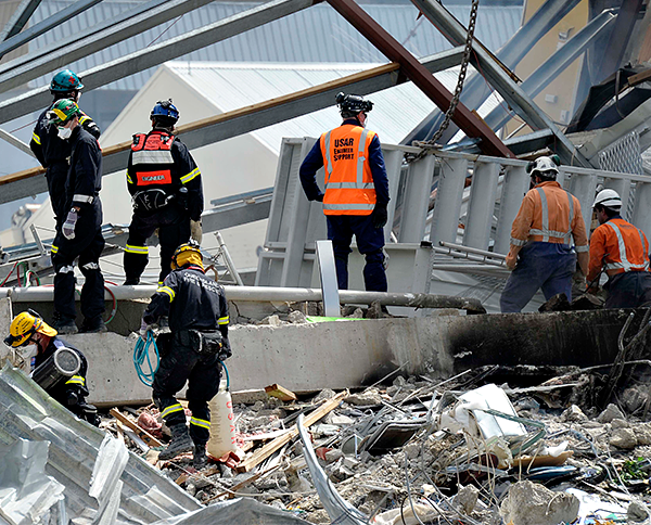 Recovery workers at the CTV building in Christchurch, New Zealand, after it crumbled in an earthquake on Feb. 24, 2011.