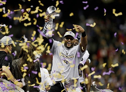 Baltimore Ravens linebacker Ray Lewis shouts while holding the the Vince Lombardi Trophy after the San Francisco 49ers in Super Bowl XLVII Sunday.