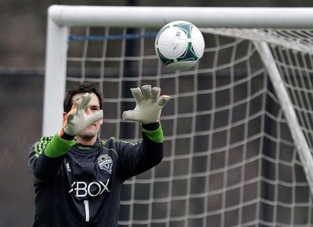 Sounders goalkeeper Michael Gspurning makes a stop during training camp.