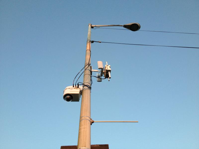 A surveillance camera sits atop a light pole along Seattle's Alki Avenue.