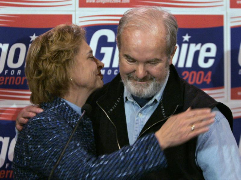 Former Gov. Christine Gregoire, left, hugs former Gov. Booth Gardner as she introduces him during a brief gathering of media and supporters, Wednesday, Nov. 24, 2004, in Seattle.