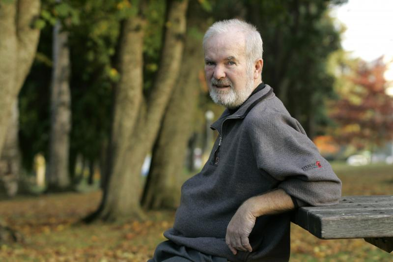 Booth Gardner, former governor of Washington, pauses Wednesday, Oct. 25, 2006, in Wright Park, near his home in Tacoma, Wash