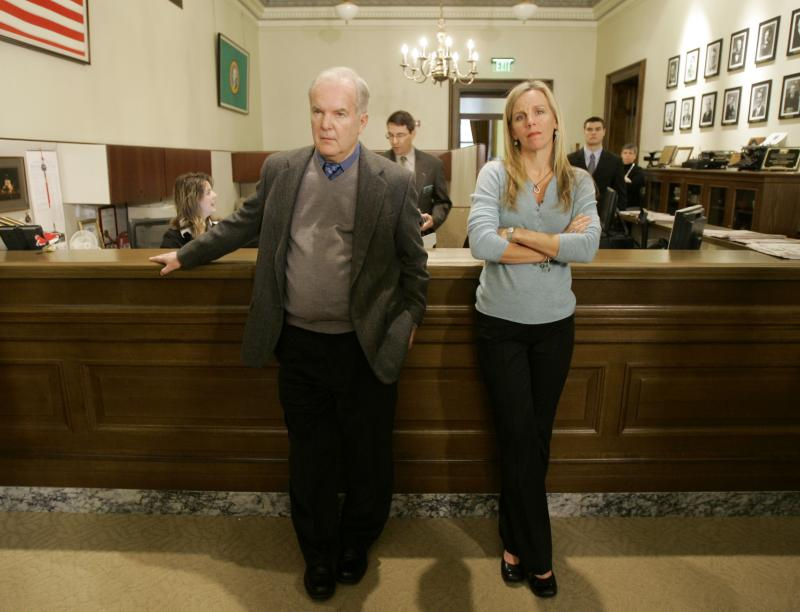 Former Washington Gov. Booth Gardner, left, stands with Julie McMurchie, right, whose mother, Peggy Sutherland, used Oregon's assisted suicide law to end her life in 2001 after a battle with lung cancer on Jan. 9, 2008.