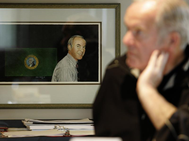 Former Washington Gov. Booth Gardner, sits in his home office next to a drawing of himself when he was Governor from 1985 to 1993, Tuesday, May 27, 2008, in Tacoma, Wash.