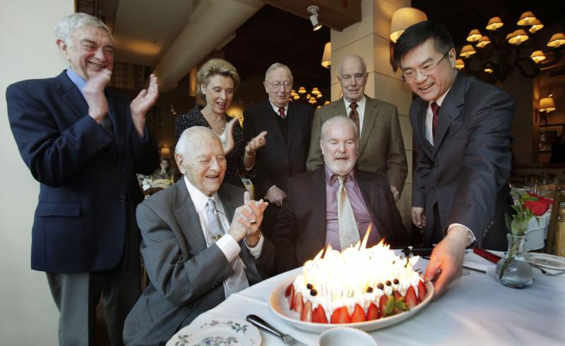 The state's former governors are seen celebrating former Gov. Booth Gardner's birthday in this 2009 file photo.