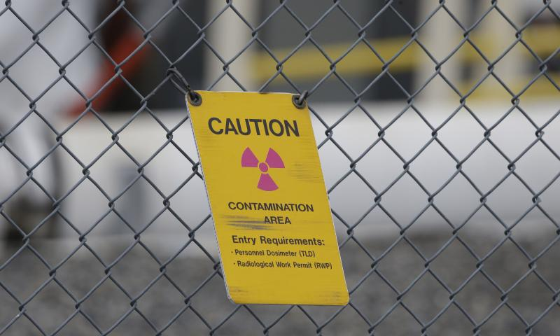 A sign warning of radioactive contamination dangles from a fence at the 'C' Tank Farm at the Hanford Nuclear Reservation, Wednesday, March 6, 2013, near Richland, Wash.
