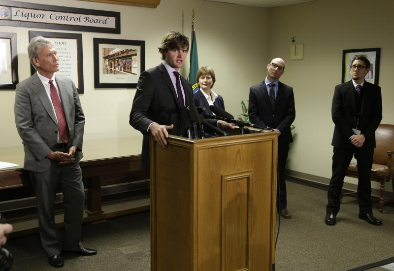 Steven Davenport, second from left, project manager for Botec Analysis Corp., takes questions from reporters Tuesday, March 19, 2013, as he is introduced in Olympia, Wash., along with other members of the team.