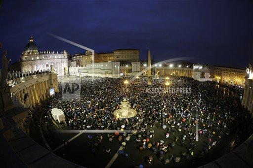 Crowds gather in St. Peter's Square to wait for the election of a new pope by the cardinals in conclave in the Sistine Chapel at the Vatican, Wednesday, March 13, 2013.