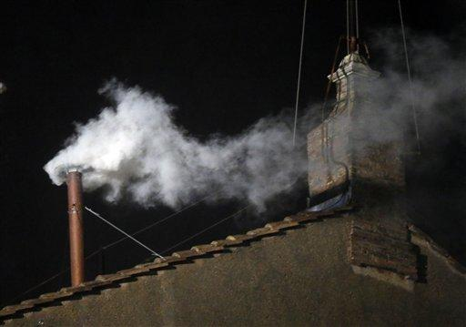 White smoke emerges from the chimney on the roof of the Sistine Chapel, in St. Peter's Square at the Vatican, Wednesday, March 13, 2013. The white smoke indicates that the new pope has been elected.