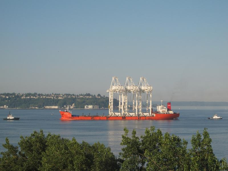 The heavy lift ship Zhenhua 23 delivers three 267-foot tall cranes to a Port of Seattle terminal Wednesday, July 25, 2012.