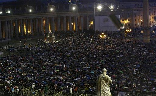 People gather in St. Peter's Square at the Vatican, Wednesday, March 13, 2013.