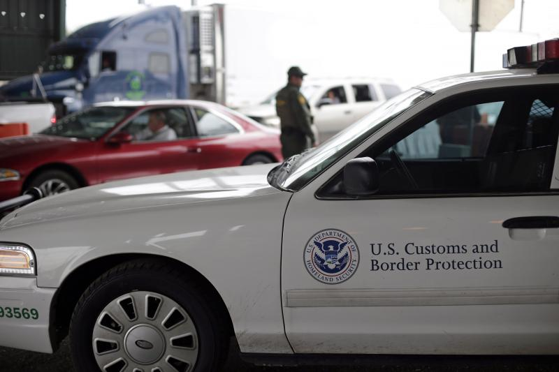 A U.S. Customs and Border Patrol agent keeps watch at a checkpoint station, Friday, Feb. 22, 2013, in Falfurrias, Texas.