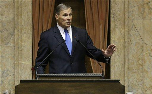 Washington Gov. Jay Inslee speaks to a joint session of the Washington Legislature, Wednesday, Jan. 16, 2013, shortly after being sworn in as Governor, at the Capitol in Olympia, Wash.