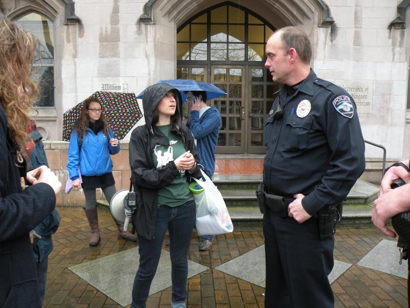 Protesters chat with police following their march into the Univesrity of Washington president's office.