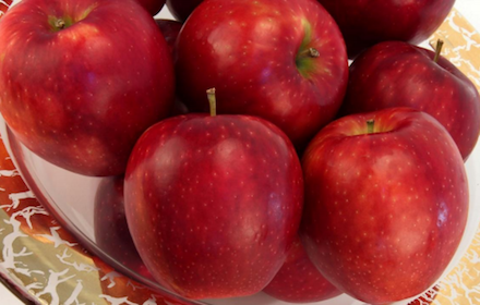 The WA-38 apple is described as crisp and slightly sweet.