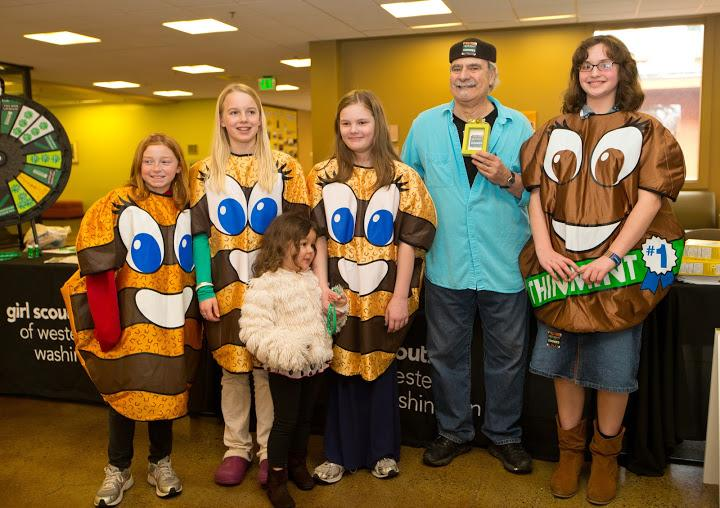"Dick Stein is honored by the Girl Scouts for suggesting a sticker saying ""I Bought Girl Scout Cookies""  in the Anderson University Center at PLU on Wednesday, March 13, 2013."