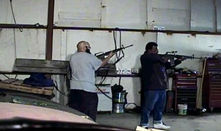 Photo from FBI showing Abu Khalid Abdul-Latif purchasing a machine gun for attack on military processing center in Seattle.