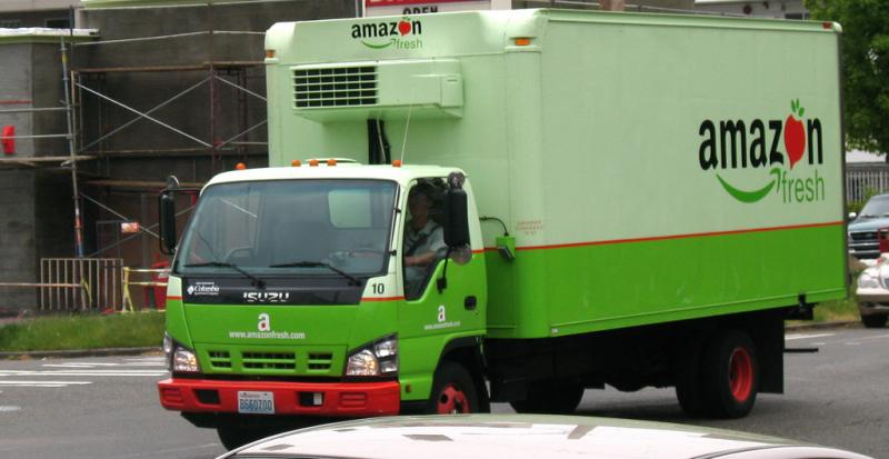 Amazon Fresh is one of the grocery delivery options in Seattle.  Others include Safeway.com and the new Seattle startup, Geniusdelivery. Google is testing a service in the San Francisco area. FreshDirect serves New York City.