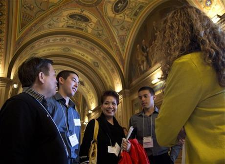Jay Mercado, left, and Shirley Tan, third from left, and their twin sons Jorien Mercado, second from left and Jashley Mercado, both 16, of Pacifica, Calif., wait on Capitol Hill in Washington, Wednesday, April 24, 2013, to meet with Senate Majority Leader