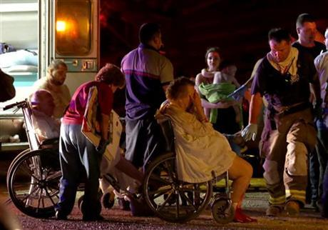 Emergency workers evacuate elderly from a damaged nursing home following an explosion at a fertilizer plant Wednesday, April 17, 2013, in West, Texas.