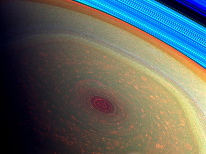 This spectacular, vertigo inducing, false-color image from NASA's Cassini mission highlights the storms at Saturn's north pole.
