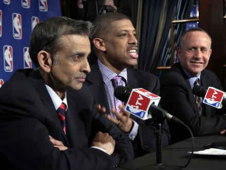 FILE - Sacramento (Calif.) Mayor Kevin Johnson, center, is joined by Vivek Ranadive, left, and California state Sen. Darrell Steinberg during interviews Wednesday, April 3, 2013, in New York.