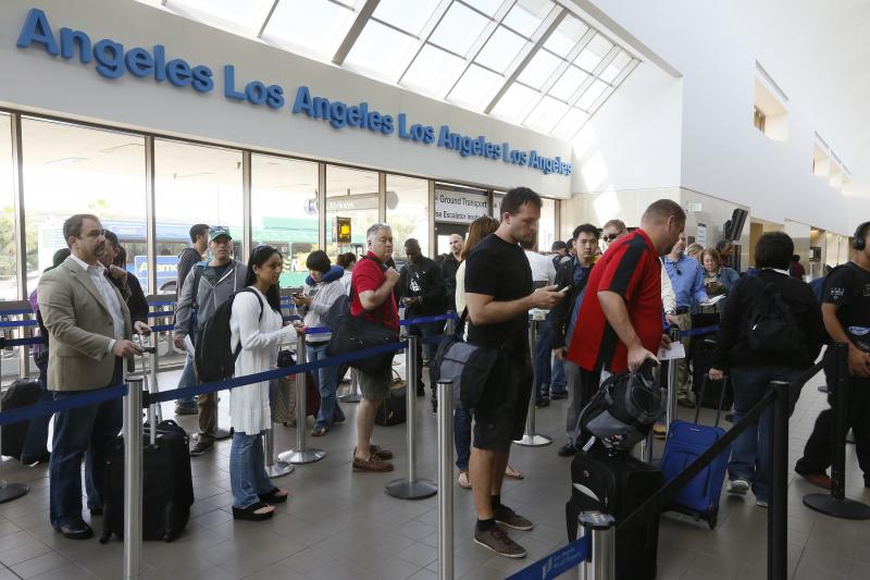 Travelers stand on line at the LAX International Airport in Los Angeles Monday, April 22, 2013.