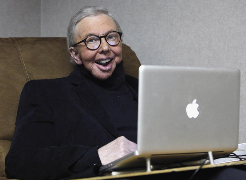 In this Jan. 12, 2011 file photo, Pulitzer Prize-winning movie critic Roger Ebert works in his office at the WTTW-TV studios in Chicago.