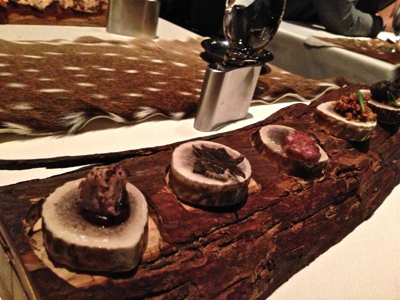 What Nancy thinks of when she thinks Chicago eating:Teensy food on antler cross sections arranged on a log.