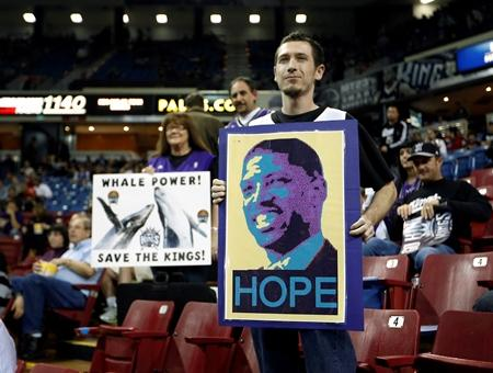 Kings fan Robert Robbins holds a poster of Sacramento Mayor Kevin Johnson before the Kings NBA basketball game against the Oklahoma City Thunder (formerly Sonics) in January.