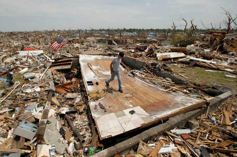 Patrick O'Banion salvages items from his devastated home in Joplin, Missouri on May 28, 2011.